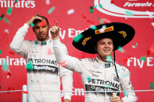 Autodromo Hermanos Rodriguez, Mexico City, Mexico. Sunday 1 November 2015. Nico Rosberg, Mercedes AMG, 1st Position, and Lewis Hamilton, Mercedes AMG, 2nd Position, on the podium. World Copyright: Charles Coates/LAT Photographic ref: Digital Image _J5R9987