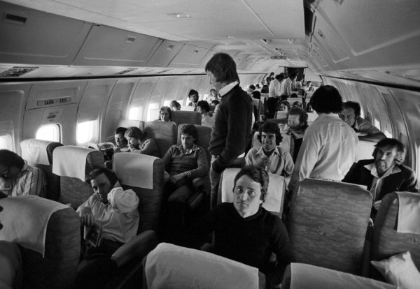 Drivers and team personnel on board a flight to Sao Paulo, including Patrick Depailler (FRA) Tyrrell (Front, right), Ronnie Peterson (SWE) Lotus (Standing), and Tom Pryce (GBR) Shadow (Sitting to the left of Peterson).Brazilian Grand Prix, Rd1, Interlagos, Brazil, 25 January 1976.