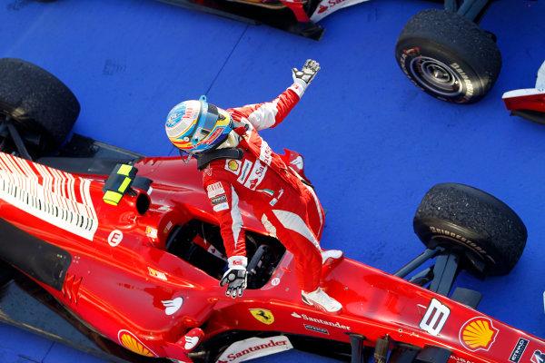 Bahrain International Circuit, Sakhir, Bahrain 14th March 2010 Fernando Alonso, Ferrari F10, 1st position, arrives in Parc Ferme. Portrait. Helmets. Finish. World Copyright: Steven Tee/LAT Photographic ref: Digital Image _A8C5584