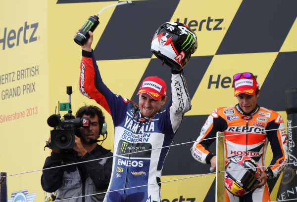 British Grand Prix.  Silverstone, England. 30th August - 1st September 2013.  Jorge Lorenzo, Yamaha, celebrates on the podium.  Ref: IMG_2462a. World copyright: Kevin Wood/LAT Photographic