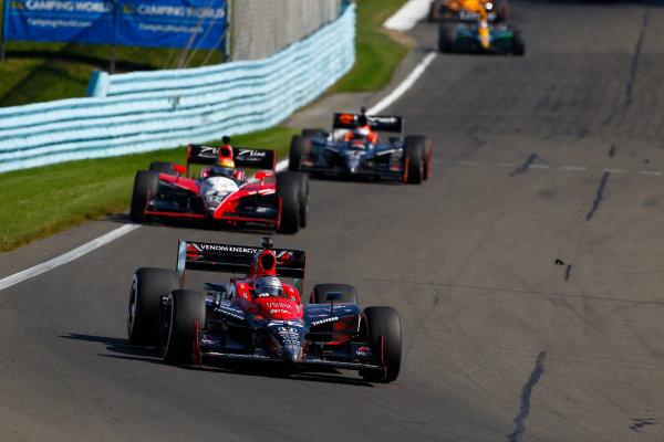 2-4 July, 2010, Watkins Glen, New York, USAMarco Andretti leads Justin Wilson, Adam Carroll and Takuma Sato.©2010, Phillip Abbott, USALAT Photographic