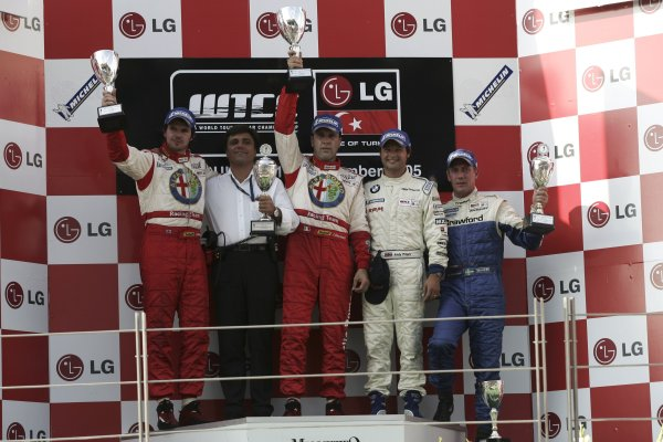 2005 World Touring Car Championship (WTCC)Istanbul, Turkey. 17th - 18th September 2005Race 1 podium - winner Fabrizio Giovanardi (Alfa Romeo Team Autodelta 156Gta) 1st position, James Thompson (Alfa Romeo Team Autodelta 156Gta)  2nd and Andy Priaulx (BMW Team Great Britain BMW 320i) 3rd, are joined by independent cup winner Carl Rosenblad (Crawford Racing BMW 320i).World Copyright: Photo4/LAT Photographicref: Digital Image Only