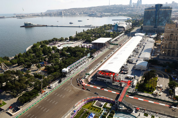 Baku City Circuit, Baku, Azerbaijan. Sunday 25 June 2017. Lewis Hamilton, Mercedes F1 W08 EQ Power+, leads Valtteri Bottas, Mercedes F1 W08 EQ Power+, Kimi Raikkonen, Ferrari SF70H, Sebastian Vettel, Ferrari SF70H, Max Verstappen, Red Bull Racing RB13 TAG Heuer, and the rest of the pack as Daniil Kvyat, Toro Roso STR12 Renault rusnwide behind. World Copyright: Steven Tee/LAT Images ref: Digital Image _O3I2962