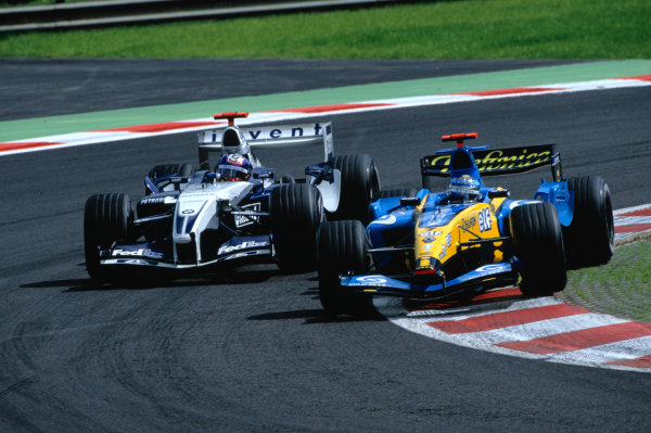 2004 Belgian Grand Prix.Spa Francorchamps, Belgium. 27th - 29th August.Juan Pablo Montoya, WilliamsF1 BMW FW26 attempts to overtake Jarno Trulli, Renault R24 going into the bus stop. Action. World Copyright:LAT PhotographicRef:35mm Image A05