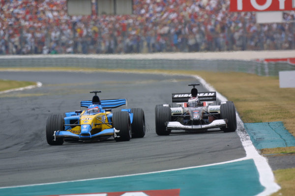 2003 French Grand Prix - Sunday RaceMagny-Cours, France.6th July 2003.Fernando Alonso, Renault R23, leads Jos Verstappen, Minardi PS03, action.World Copyright LAT Photographic.Digital Image Only.