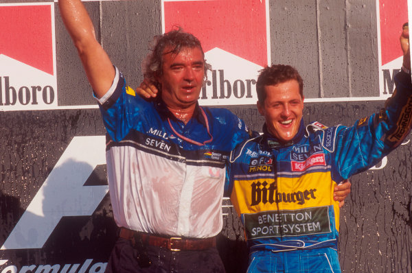 Tanaka International, Aida, Japan.20-22 October 1995.Michael Schumacher (Benetton Renault) 1st position with team boss Flavio Briatore, celebrate taking his second successive drivers world championship on the podium.Ref-95 PAC 08.World Copyright - LAT Photographic