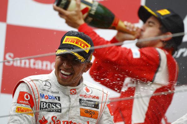 Nurburgring, Germany.24th July 2011Lewis Hamilton, McLaren MP4-26 Mercedes, 1st position, sprays the Champagne. Portrait. Podium. World Copyright: Andy Hone/LAT Photographicref: Digital Image CSP13517