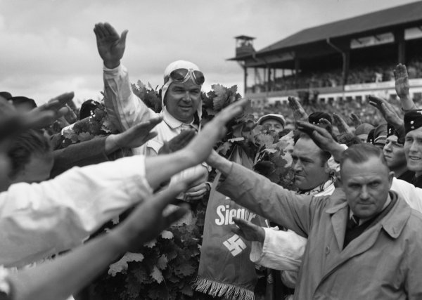 Nurburgring, Germany. 23rd July 1939.Rudolf Caracciola (Mercedes Benz W154) salutes the Fuhrer after his race win. It was the last victory of his career.World Copyright: Robert Fellowes / LAT Photographic
