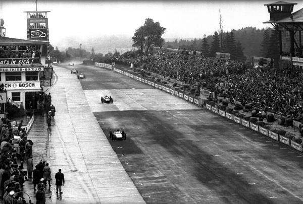 The then race leader and overall third place finisher Dan Gurney (USA) Porsche 804 leads race winner Graham Hill (GBR) BRM P57. German Grand Prix, Nurburgring, 5 August 1962.