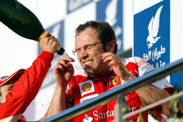 Bahrain International Circuit, Sakhir, Bahrain14th March 2010Stefano Domenicali, Sporting Director, Ferrari, gets a soaking on the podium from Felipe Massa, Ferrari F10, 2nd position. Portrait. Podium. World Copyright: Andrew Ferraro/LAT Photographicref: Digital Image _Q0C5853