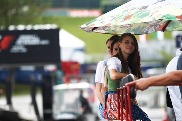Red Bull Ring, Spielberg, Austria. Thursday 18 June 2015. Girls on a tractor. World Copyright: Sam Bloxham/LAT Photographic. ref: Digital Image _G7C3052