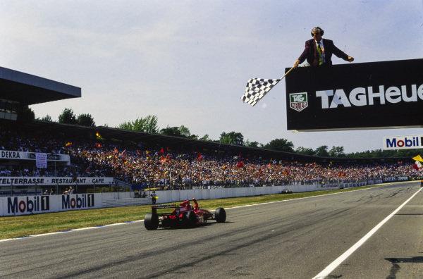 Gerhard Berger, Ferrari 412T1B, celebrates as he takes the chequered flag.