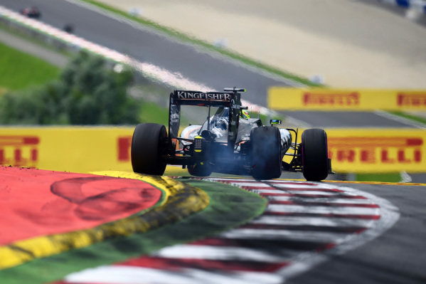 Sergio Perez (MEX) Force India VJM09 and breaks his suspension on the kerb at Formula One World Championship, Rd9, Austrian Grand Prix, Qualifying, Spielberg, Austria, Saturday 2 July 2016. BEST IMAGE