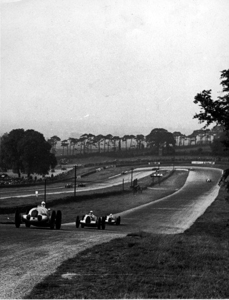 1937 Donington Grand Prix.Donington Park, Great Britain.2 October 1937.A Mercedes-Benz W125 leads eventual winner Bernd Rosemeyer and Hermann Muller (both Auto Union C-typ) on the original Melbourne loop.World - LAT Photographic