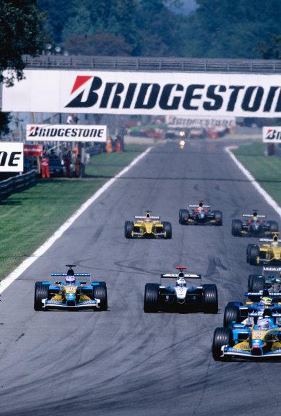 2002 Italian Grand PrixMonza, Italy. 14th - 16th September 2002Jarno Trulli, Renault R202 leads Felipe Massa, Sauber Petronas C21, David Coulthard, West McLaren Mercedes MP4/17, and Jenson Button, Renault R202.World Copyright - LAT Photographicref: 35mm Transparency 02_ITA_06