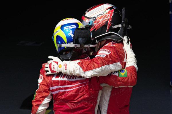 Teammates Felipe Massa and Kimi Räikkönen congratulate each other on their 1-2 in parc fermé.