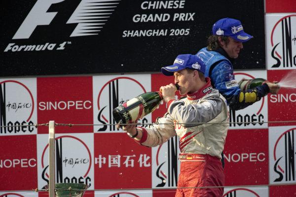 Ralf Schumacher, 3rd position, celebrates on the podium.