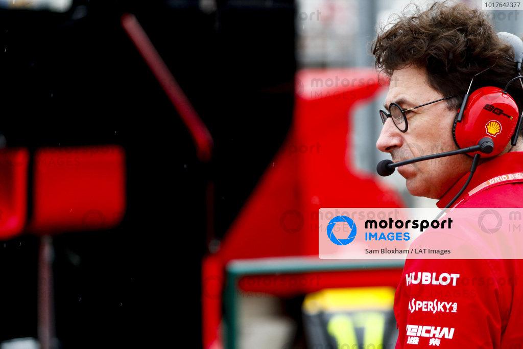 Mattia Binotto, Team Principal Ferrari watches rain falling in the pit lane