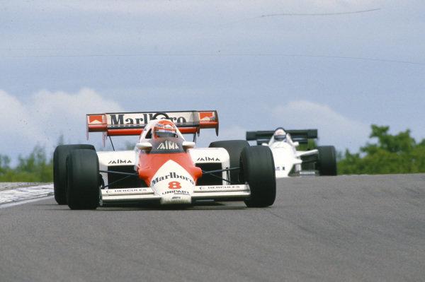 Niki Lauda, McLaren MP4-2 TAG, leads Mauro Baldi, Spirit 101 Hart.