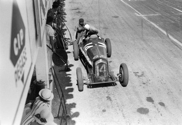 Achille Varzi climbs from his Alfa Romeo Tipo B.
