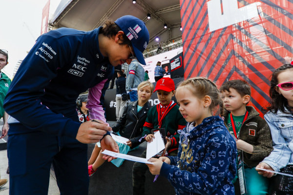 Lance Stroll, Racing Point signs an autograph for a young fan