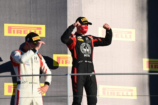 Nikita Mazepin (RUS, HITECH GRAND PRIX), 1st position, and Luca Ghiotto (ITA, HITECH GRAND PRIX), celebrate on the podium