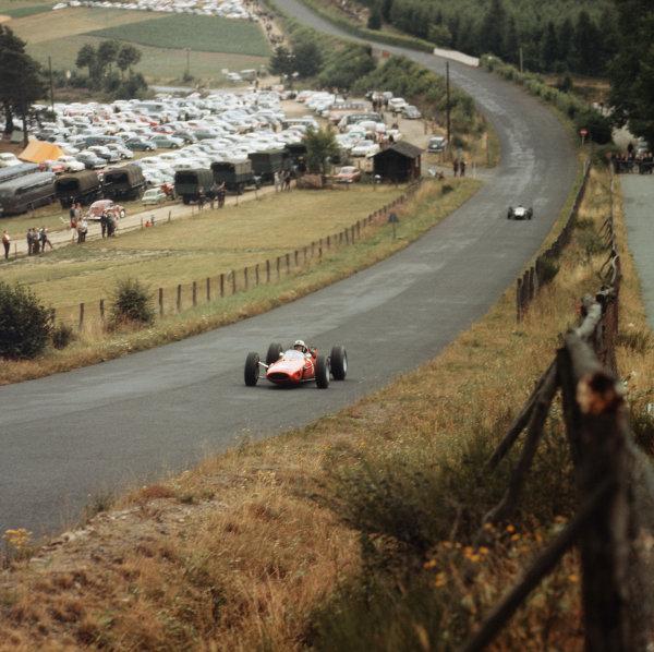 Nurburgring, Germany. 31/7-2/8 1964.  John Surtees (Ferrari 158) 1st position, at Flugplatz.  Ref-3/1373. World Copyright - LAT Photographic