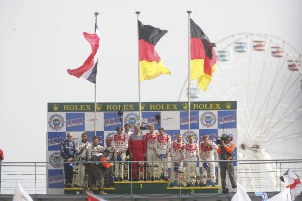 2006 Le Mans 24 Hours, Le Mans, France.14th - 18th June. LMP1 Podium. F Biela (DEU)/ E Pirro (ITA)/ M Werner (DEU), Audi Sport Team Joest. E Helary (FRA)/ S Loeb (FRA)/ F Montagny (FRA), Pescarolo Sport, Pescarolo Judd. and R Capello (ITA)/ T Kristensen (DNK)/ A McNish (GBR), Audi Sport Team Joest. Celebrate their win on the podium.World Copyright: Andrew Ferraro/LAT PhotographicRef: Digital Image Only ZP9O1495