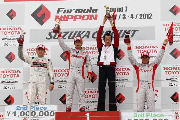 Suzuka Circuit, Japan. Rd 7 - 3rd - 4th November 2012. Race1 Winner Takuya Izawa ( #40 DOCOMO TEAM DANDELION RACING ) 2nd position Tsugio Matsuda ( #20 TEAM IMPUL ) 3rd position Koudai Tsukakoshi ( #41 DOCOMO TEAM DANDELION RACING ) podium, portrait. World Copyright: Yasushi Ishihara/LAT Photographic ref: Digital Image 2012FN_Rd7_007