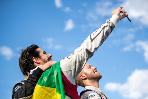 Lucas Di Grassi (BRA), Audi Sport ABT Schaeffler, Audi e-tron FE04, and Sam Bird (GBR), DS Virgin Racing, DS Virgin DSV-03, celebrate on the podium.