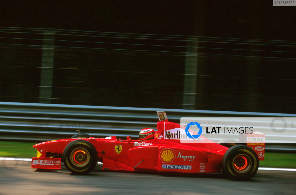 Monza, Italy.5-7 September 1997.Eddie Irvine (Ferrari F310B) 8th position.Ref-97 ITA 18.World Copyright - LAT Photographic