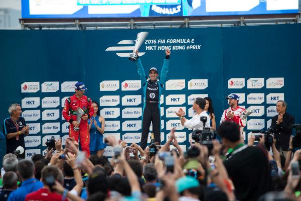 2016/2017 FIA Formula E Championship. Hong Kong ePrix, Hong Kong, China. Sunday 9 October 2016. Lucas Di Grassi (BRA), ABT Schaeffler Audi Sport, Spark-Abt Sportsline, ABT Schaeffler FE02, Sebastien Buemi (SUI), Renault e.Dams, Spark-Renault, Renault Z.E 16 and Nick Heidfeld (GER), Mahindra Racing, Spark-Mahindra, Mahindra M3ELECTRO on the podium. Photo: Andrew Ferraro/LAT/Formula E ref: Digital Image _FER2482
