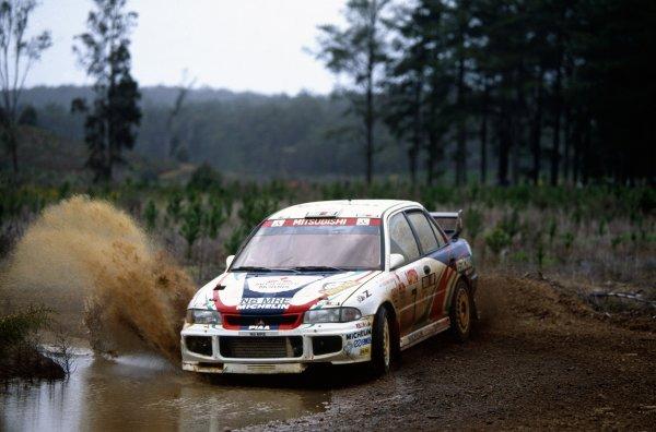 1996 World Rally Championship.Australian Rally, Australia. 13-16 September 1996.Tommi Makinen/Seppo Harjanne (Mitsubishi Lancer Evo3)1st position.World Copyright: LAT PhotographicRef: 35mm transparency 96RALLY07