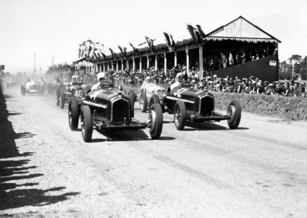 "1935 Dieppe Grand Prix Dieppe, France. 21 July 1935 Rene Dreyfus, Alfa Romeo Tipo-B ""P3"", 1st position, leads Louis Chiron, Alfa Romeo Tipo-B ""P3"", 2nd position, Marcel Lehoux, Maserati 6C-34, retired, and Giuseppe Farina, Maserati 6C-34, 5th position, at the start, action World Copyright: Robert Fellowes/LAT PhotographicRef: 35DIE04"
