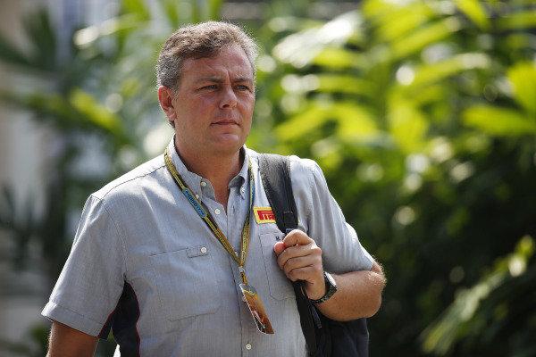 Marina Bay Circuit, Singapore. Sunday 21 September 2014. A Pirelli employee arrives at the track. World Copyright: Charles Coates/LAT Photographic. ref: Digital Image _N7T4170