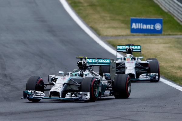 Red Bull Ring, Spielberg, Austria. Sunday 22 June 2014. Nico Rosberg, Mercedes F1 W05 Hybrid, leads Lewis Hamilton, Mercedes F1 W05 Hybrid. World Copyright: Glenn Dunbar/LAT Photographic. ref: Digital Image _89P7712