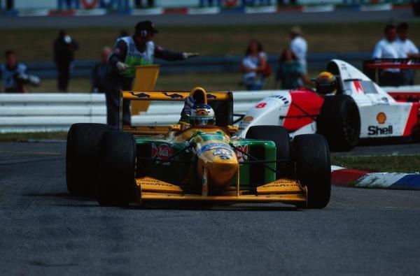 Michael Schumacher (GER) Benetton B193B waves to the German fans after taking 2nd place. German Grand Prix, Hockenheim, 25 July 1993