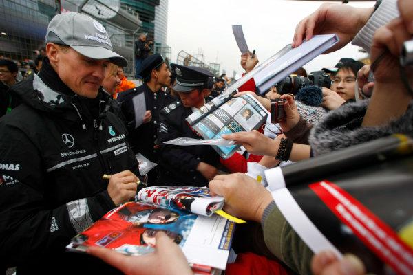 Shanghai International Circuit, Shanghai, China15th April 2010Michael Schumacher, Mercedes GP W01, signs some autographs for fans. Portrait. Atmosphere. World Copyright: Charles Coates/LAT Photographicref: Digital Image _26Y7887