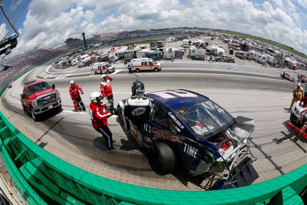 27-29 June, 2013, Sparta, Kentucky, USA Brad Keselowski gets out of his car after the crash © 2013, Michael L. Levitt LAT Photo USA