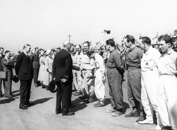 1950 British Grand Prix.Silverstone, Great Britain. 13th May 1950.King George VI meets the drivers including a young Stirling Moss in the foreground.World Copyright: LAT Photographicref: B&W Print