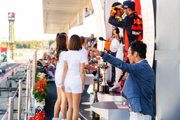 Suzuka Circuit, Japan. Sunday 8 October 2017. Takuma Sato on the podium after interviewing the drivers. World Copyright: Joe Portlock/LAT Images  ref: Digital Image _L5R9975