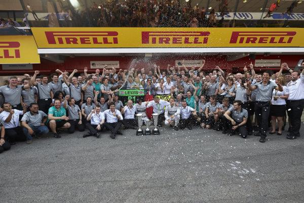 Circuit de Catalunya, Barcelona, Spain. Sunday 11 May 2014. Lewis Hamilton, Mercedes AMG, 1st Position, Nico Rosberg, Mercedes AMG, 2nd Position, and the Mercedes AMG team celebrate a perfect weekend. World Copyright: Steve EtheringtonLAT Photographic. ref: Digital Image SNE25431 copy