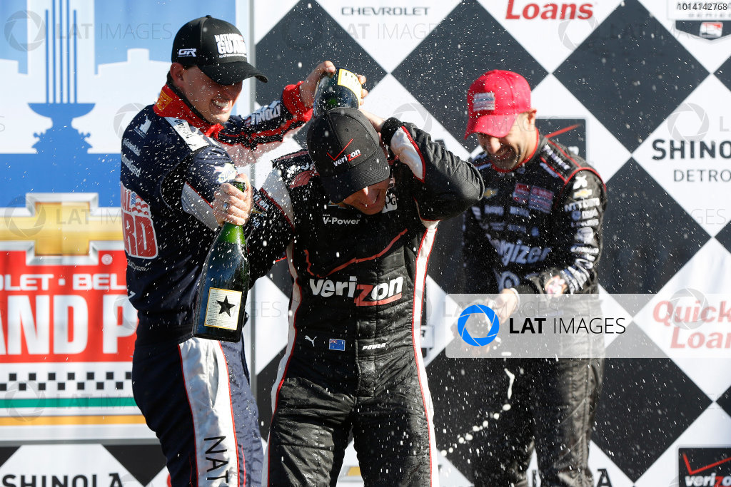 30 May - 1 June, 2014, Detroit, Michigan, USA Graham Rahal, Will Power and Tony Kanaan on the podium with champagne ©2014, Michael L. Levitt LAT Photo USA
