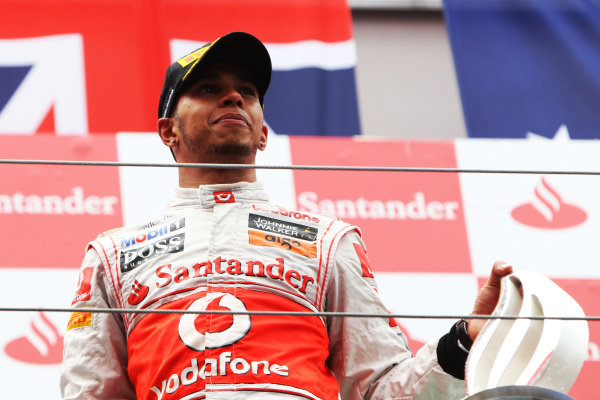 Race winner Lewis Hamilton (GBR) McLaren celebrates on the podium. Formula One World Championship, Rd 10, German Grand Prix, Race, Nurburgring, Germany, Sunday 24 July 2011.