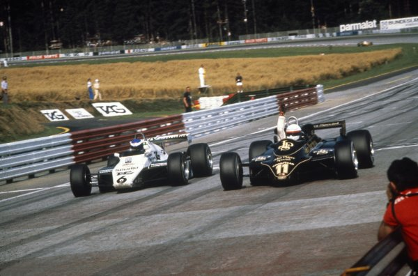 1982 Austrian Grand Prix.Osterreichring, Austria. 15 August 1982.Elio de Angelis, Lotus 91-Ford, 1st position, beats Keke Rosberg, Williams FW08-Ford, 2nd position, at the finish, action.World Copyright: LAT PhotographicRef: 35mm transparency 82AUT