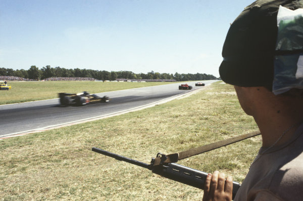 1978 Argentinian Grand Prix  Buenos Aires, Argentina. 13-15th January 1978.  A soldier looks on from the side of the track.  Ref: 78ARG02. World Copyright: LAT Photographic