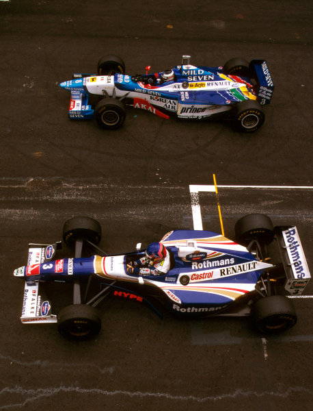 Interlagos, Brazil.28-30 March 1997.Jacques Villeneuve (Williams FW19 Renault) parks up after his victory. Alongside is Gerhard Berger (Benetton B197 Renault) who finished in 2nd position. World Copyright - LAT Photographic