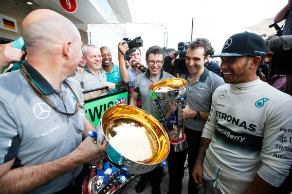 Circuit of the Americas, Austin, Texas, United States of America. Sunday 2 November 2014. Lewis Hamilton, Mercedes AMG, 1st Position, celebrates with his team. World Copyright: Charles Coates/LAT Photographic. ref: Digital Image _J5R1534