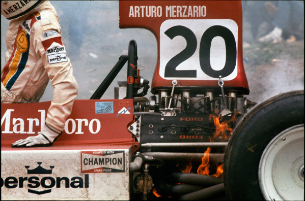1974 Spanish Grand Prix.  Jarama, Madrid, Spain. 26-28th April 1974.  Arturo Merzario climbs out of his Williams FW03 Ford with flames coming from the back of the car.  Ref: 74ESP21. World Copyright: LAT Photographic
