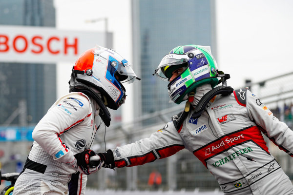 Lucas Di Grassi (BRA), Audi Sport ABT Schaeffler, 3rd position congratulates race winner Sam Bird (GBR), Envision Virgin Racing in parc ferme